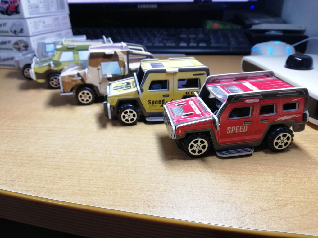 All five pullback toy cars built and lined up